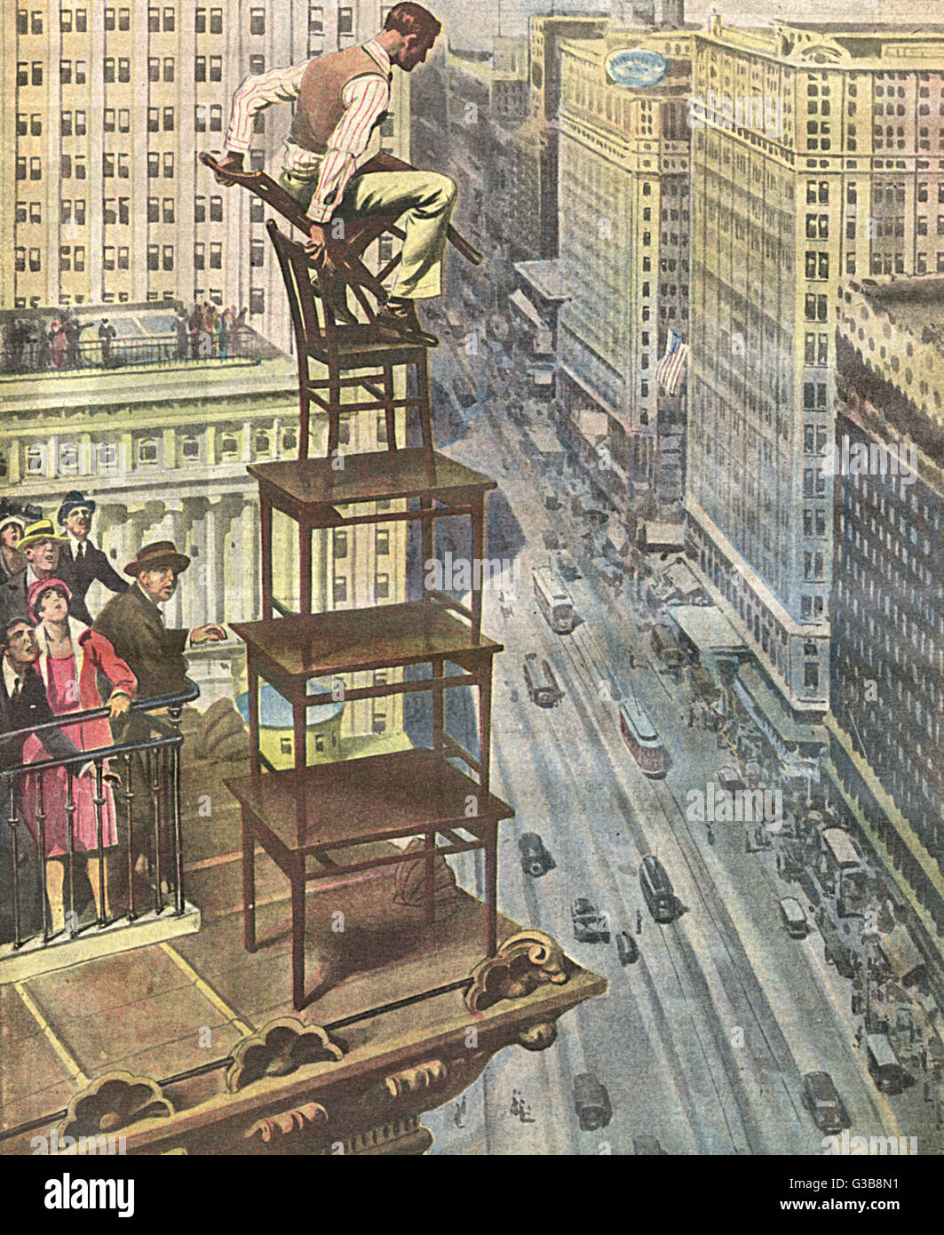 A stuntman builds a tower of  tables and chairs on the top  of a New York skyscraper and  perches himself at the - Stock Image