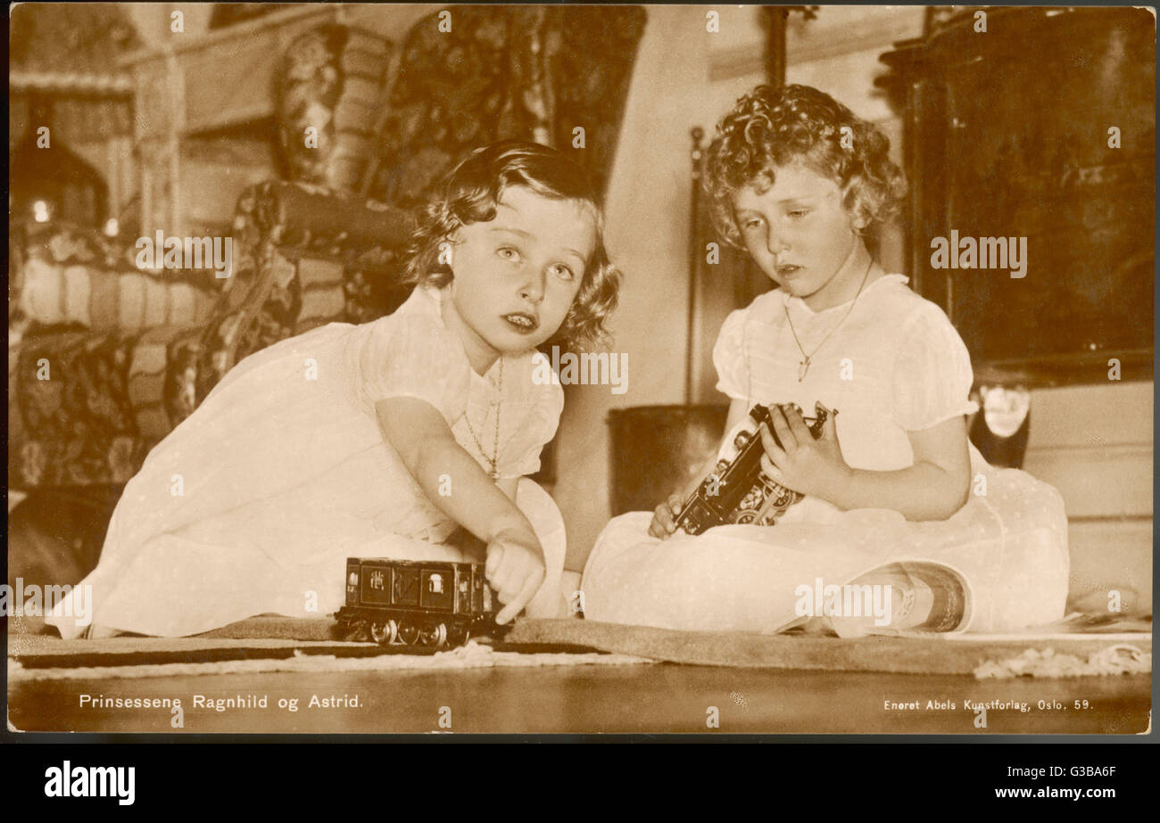 Two little girls (Princesses  Astrid and Ragnhild of Norway)  playing with their toy train  set       Date: circa - Stock Image