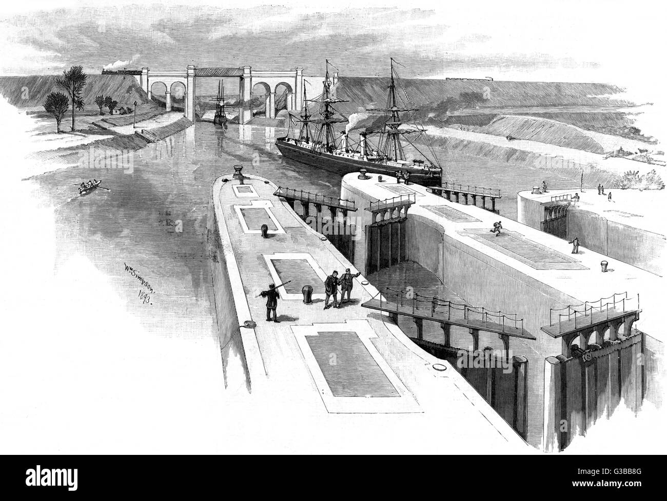 A steamer enters Irlam Lock :  a railway train crosses the  viaduct.        Date: 1893 - Stock Image