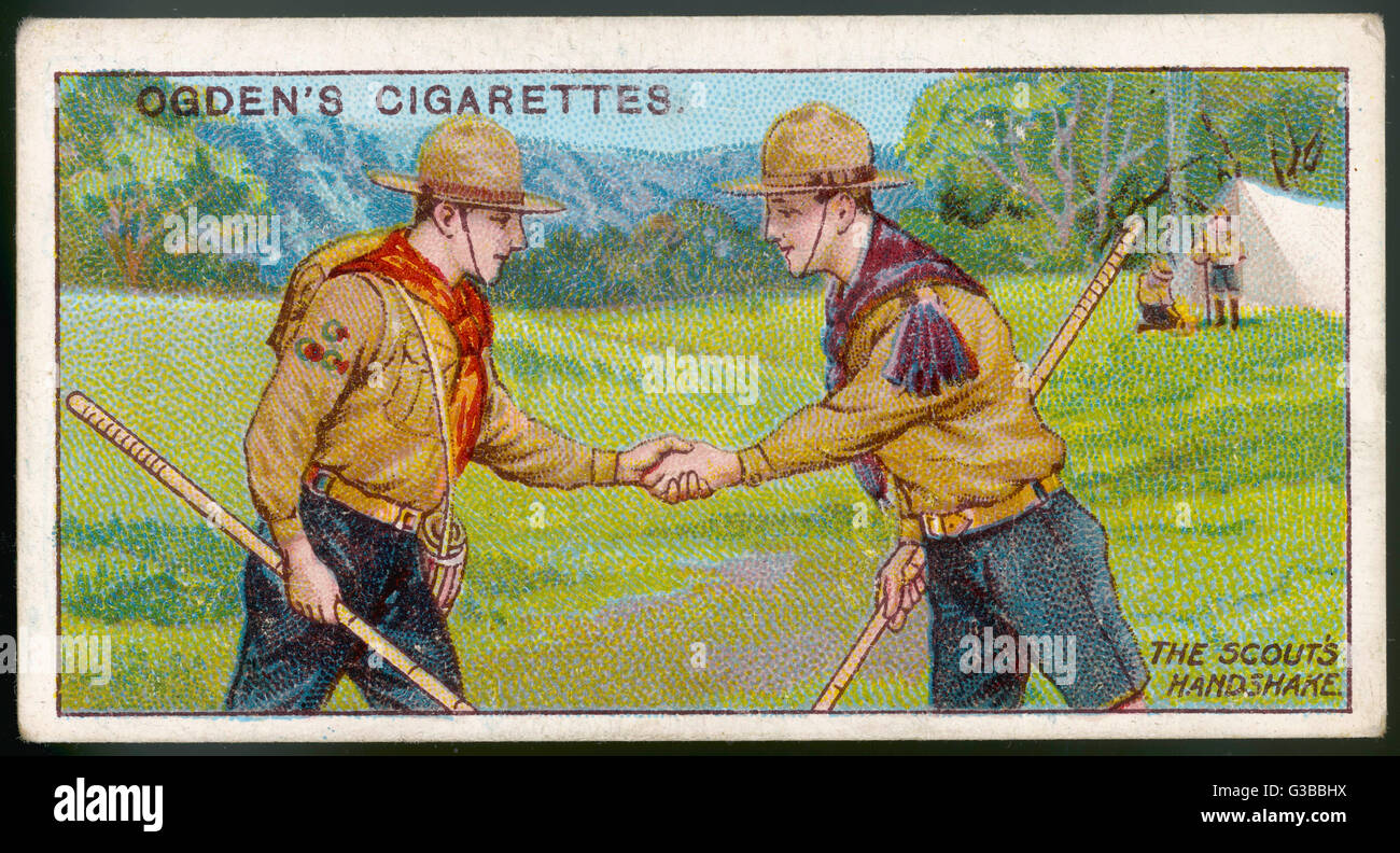 Two scouts doing a special  left-handed handshake        Date: early 20th century - Stock Image