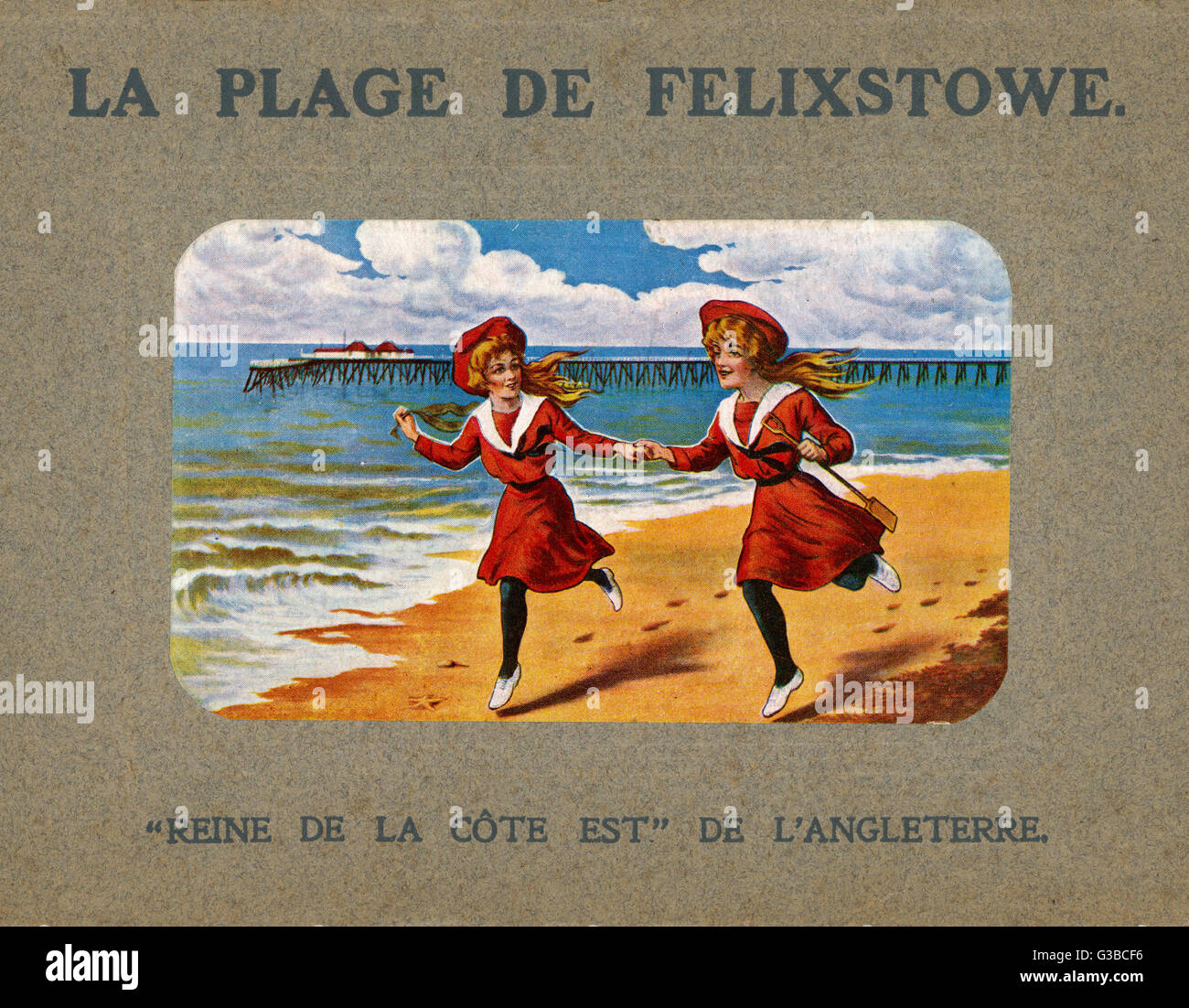 Two girls in look-alike  costume run hand in hand along  the sand at Felixstowe,  Suffolk.      Date: circa 1903 - Stock Image