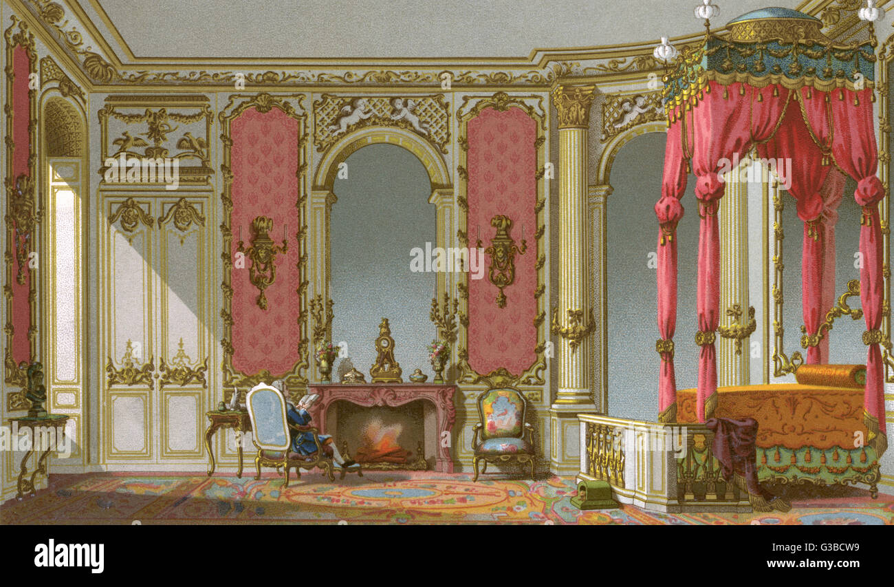 An ornate French bedroom with  a richly decorated bed.         Date: circa 18th century - Stock Image