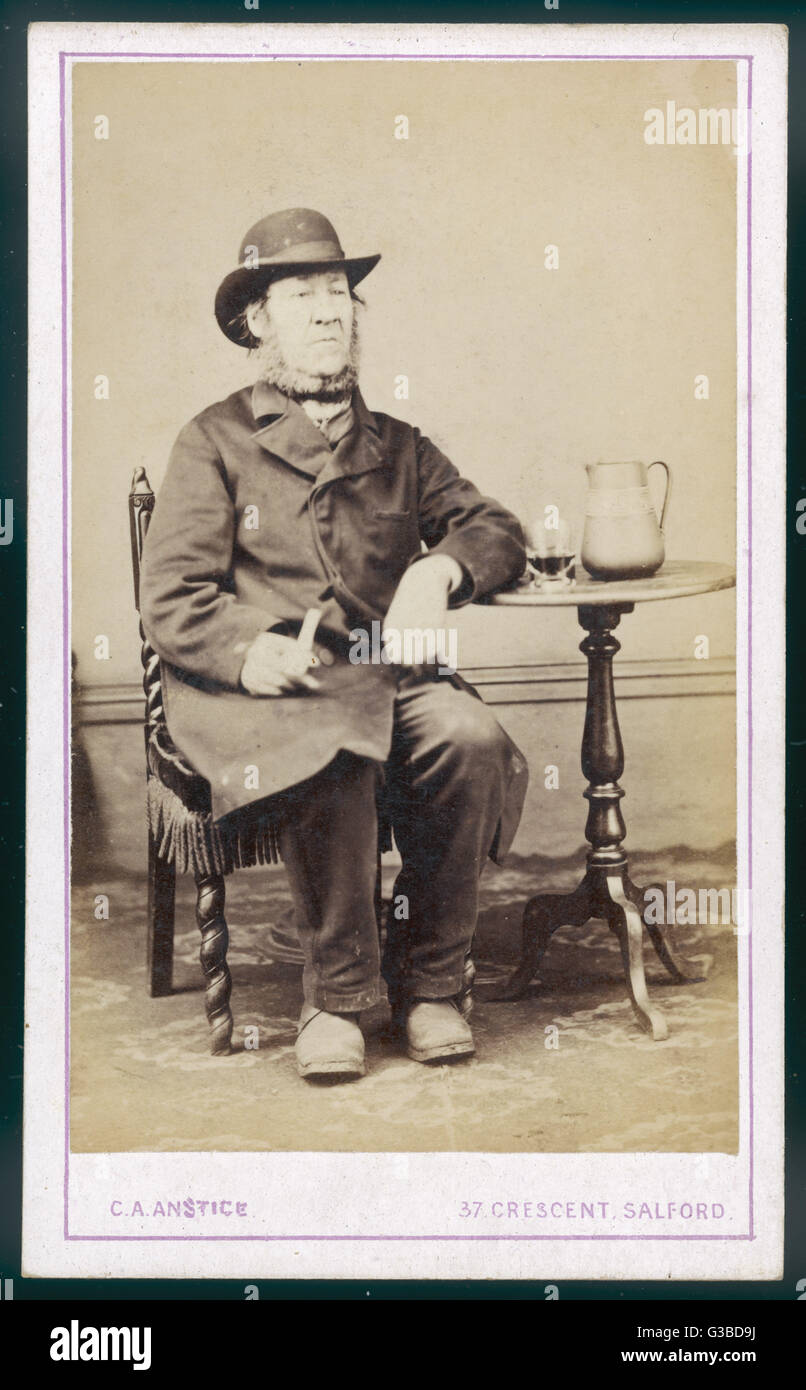 A middle-aged country type, photographed in a studio.        Date: circa 1870 - Stock Image
