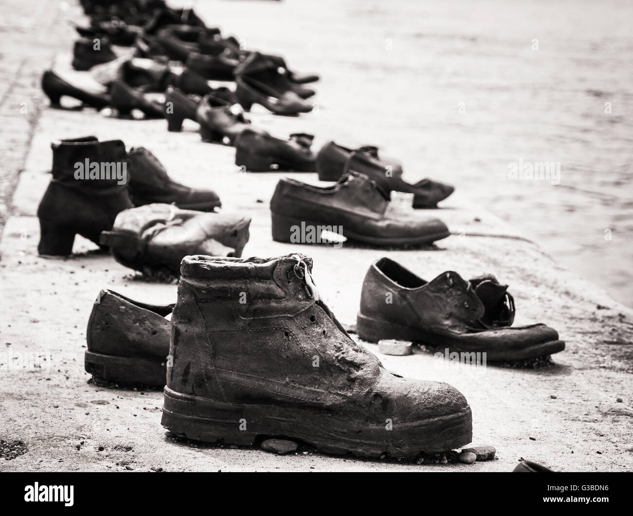 Shoes on the Danube bank is a memorial in Budapest, Hungary. Place of reverence. Black and white photo. Cultural - Stock Image