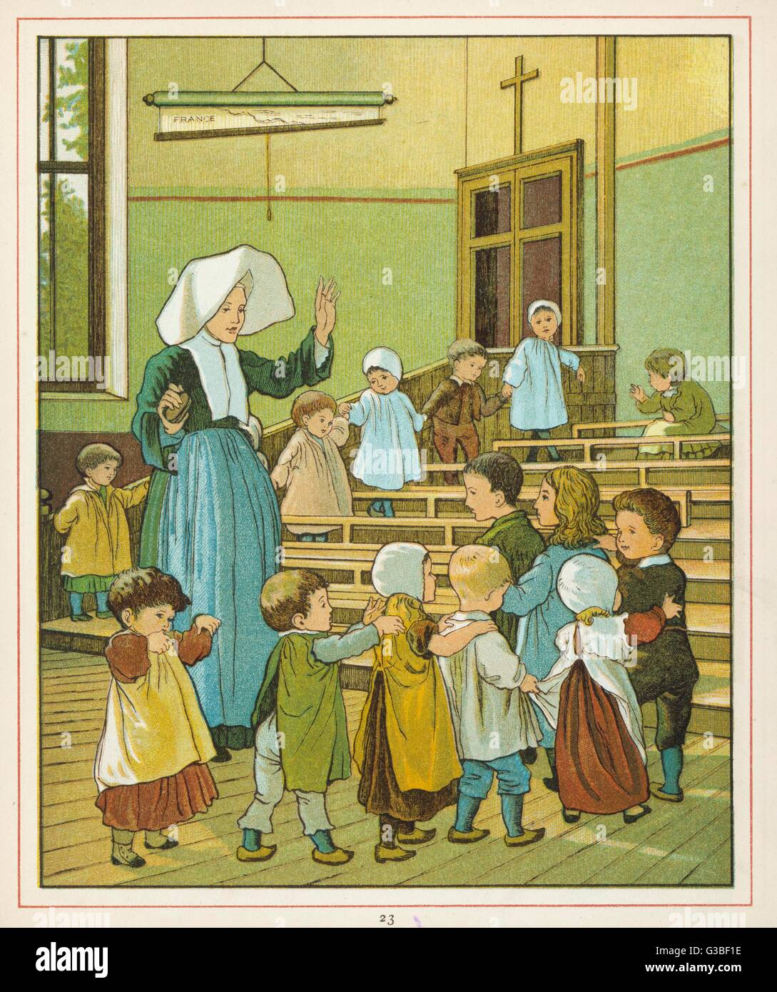 A nun with a class of children  at a French infants school.        Date: 1882 - Stock Image