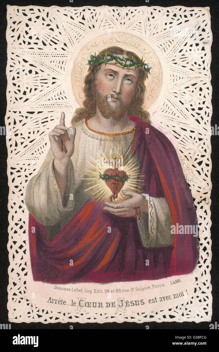 Jesus holds his sacred heart in one hand, raises a pointing finger Stock  Photo - Alamy