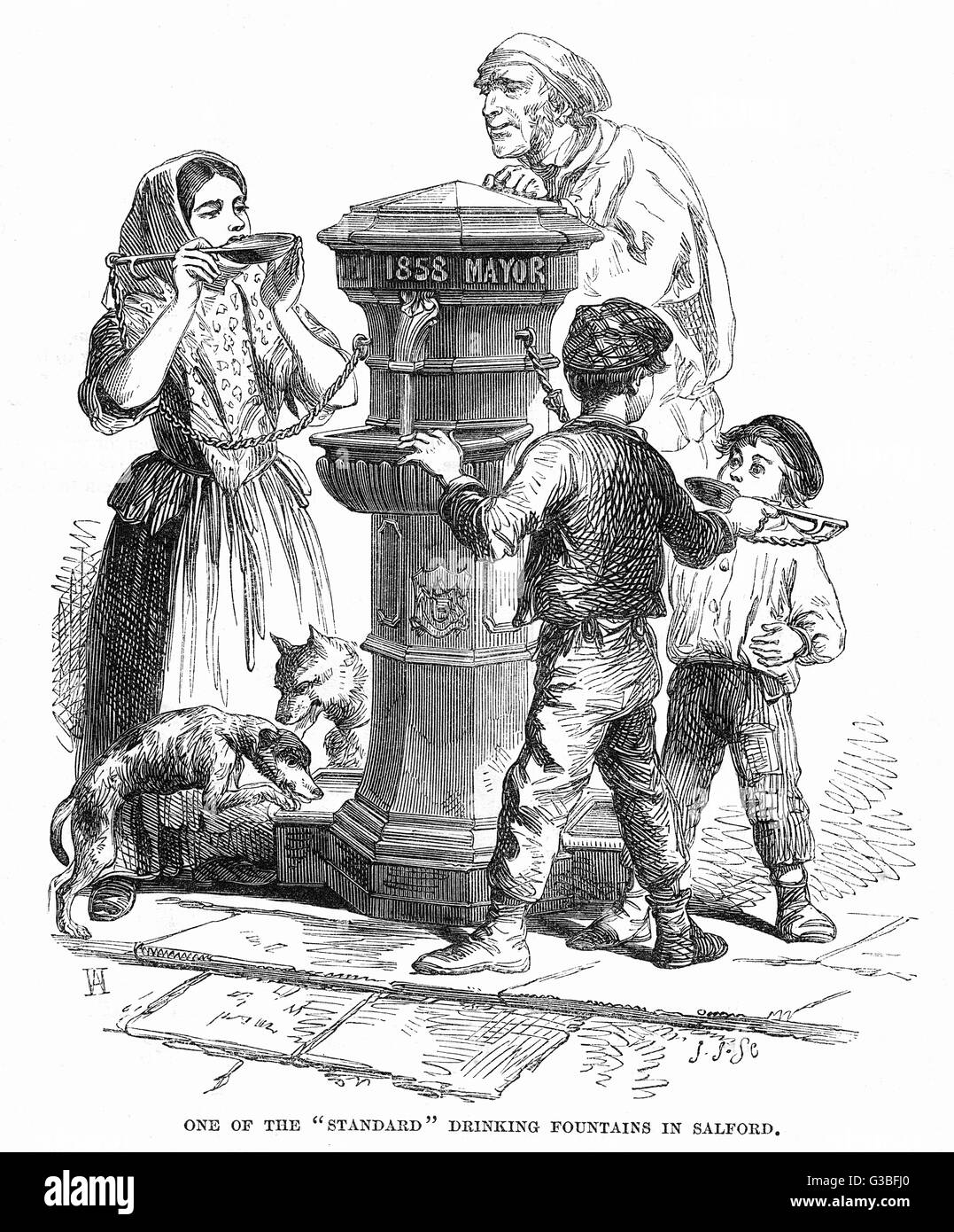 Men, children and even dogs slake their thirst at a  'Standard' drinking fountain  in Salford, Manchester. - Stock Image