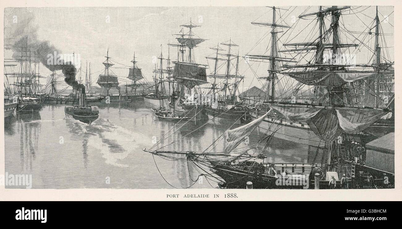 Sailing vessels and a paddle- driven steam tug in the port.        Date: 1888 - Stock Image