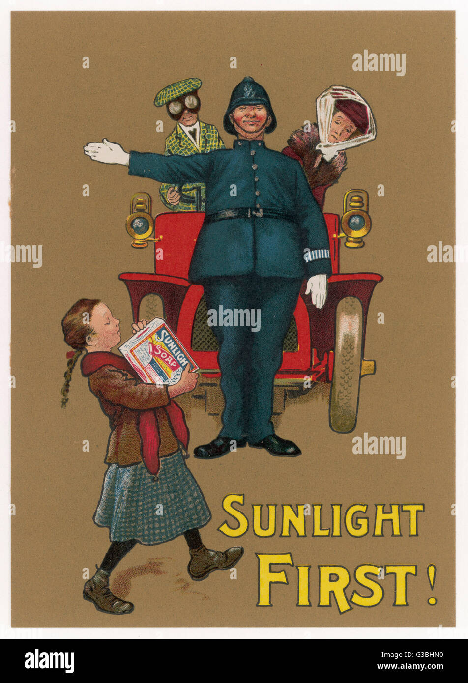 A policeman holds up an early  motor car so that a small girl  may cross the road safely with  her precious packet - Stock Image
