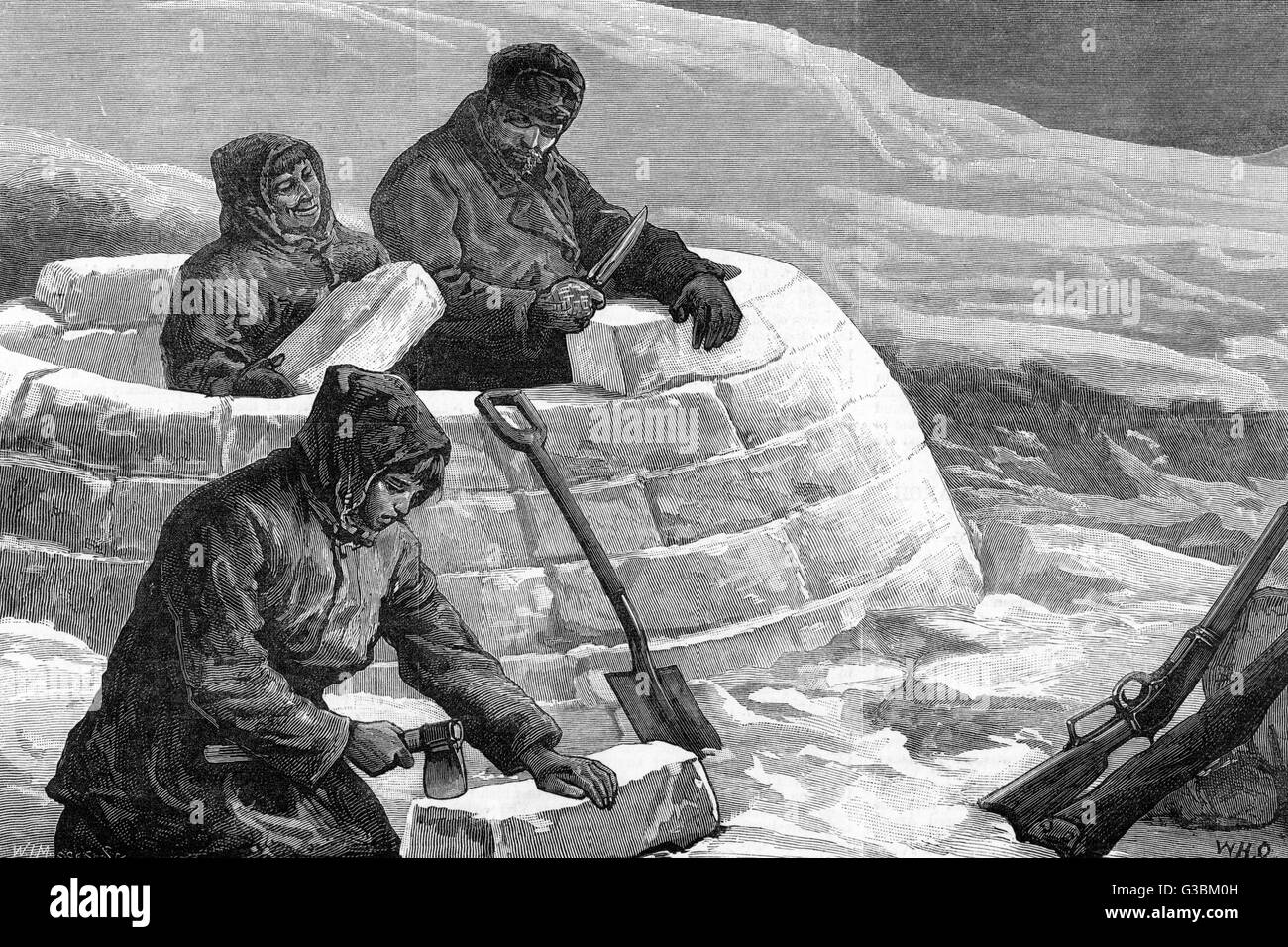 Building an igloo, or snow- house, using blocks of ice