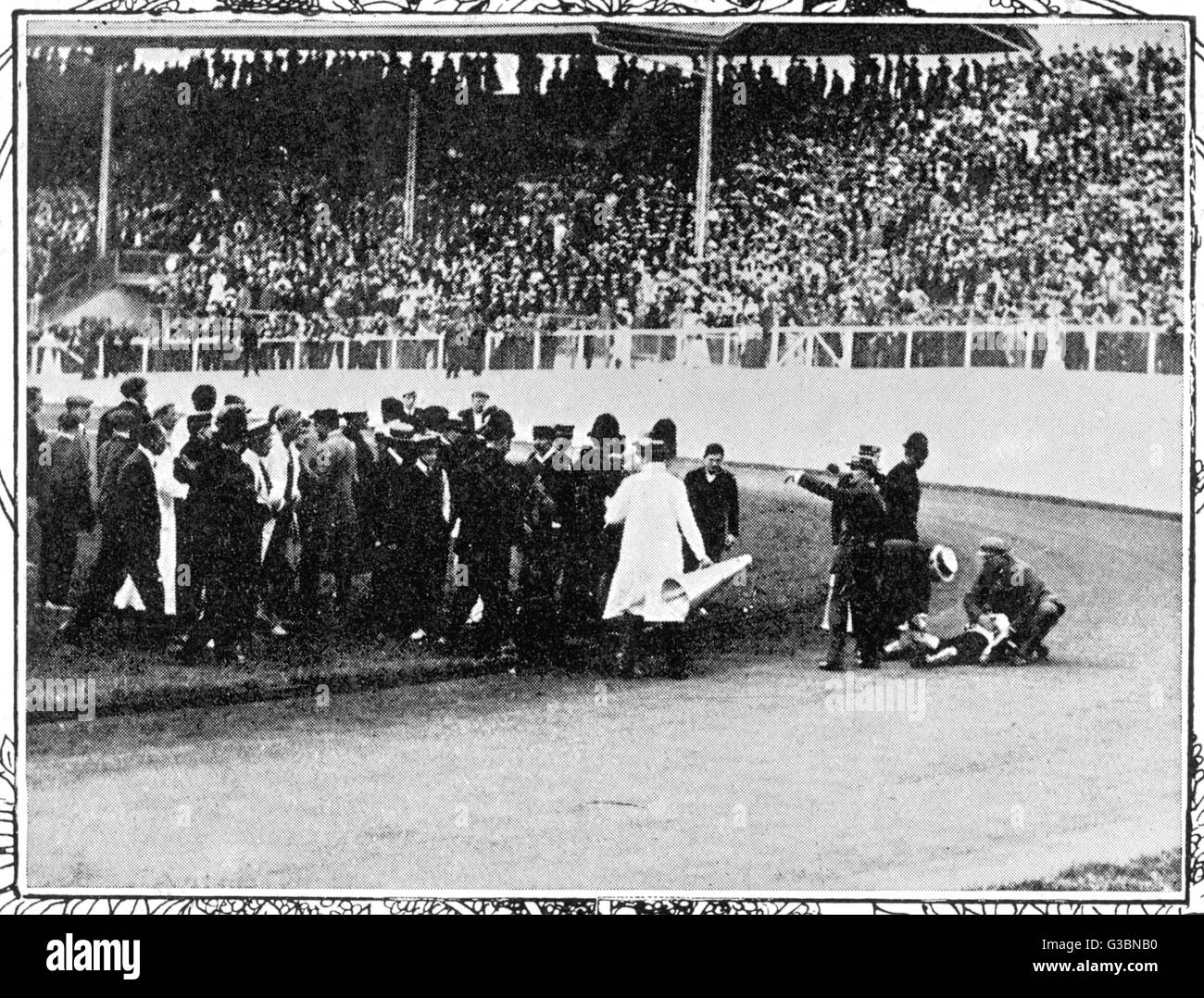 Olympic marathon 1908: Dorando Pietri falls exhausted on the stadium track. He will  finish first but will be disqualified Stock Photo