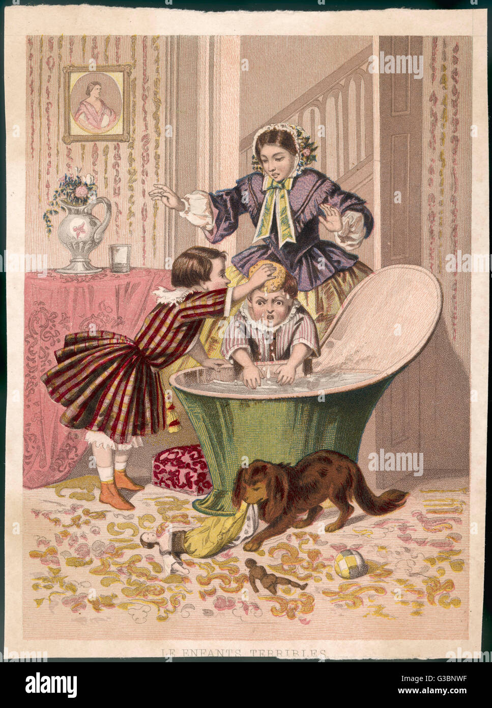 Two badly behaved boys, both  dressed in frocks, have a  water fight in a hip bath much  to the horror of mama. - Stock Image