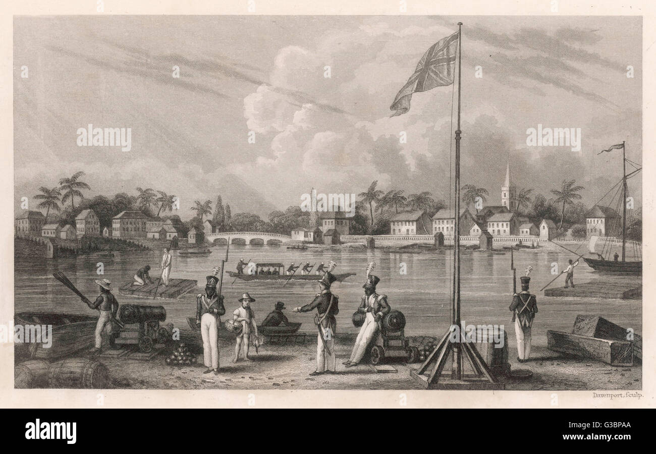 Port of Belize (Balize) in  what was British Hondurus.  Troops watch as locals move  about on rafts possibly made - Stock Image