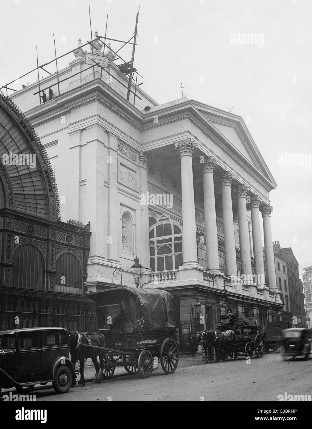 Royal Opera House, Covent Garden, London, with reconstruction to the stonework taking place.  The Floral Hall is - Stock Image