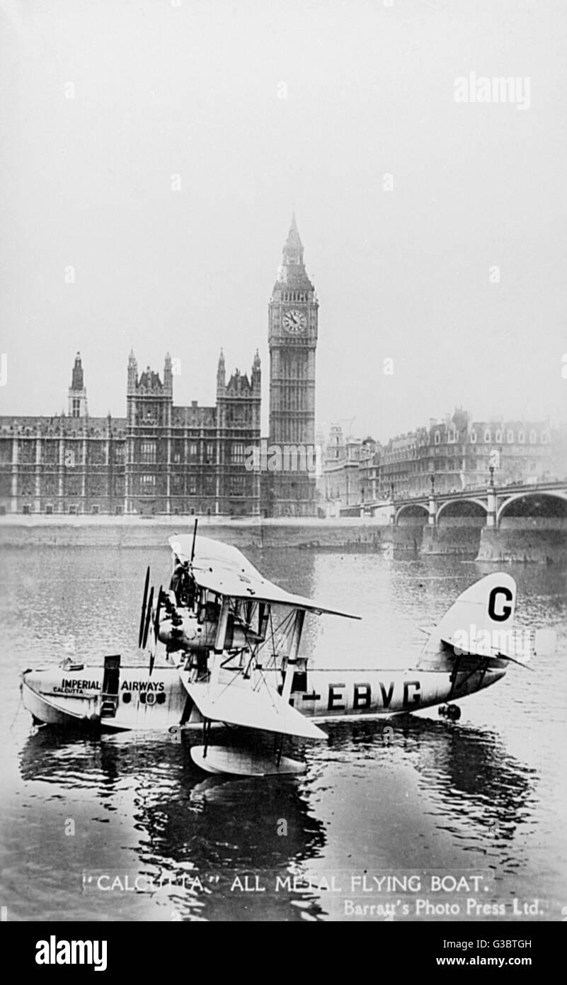 Imperial Airways all-metal flying boat Calcutta, on the River Thames at Westminster, London, in front of the Houses - Stock Image