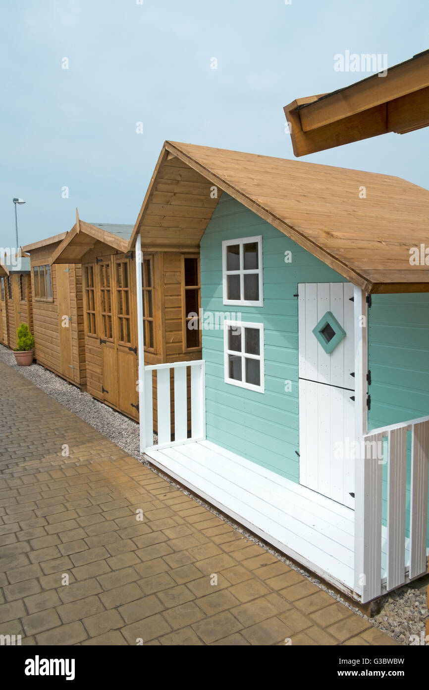 Tanalised timber workshop, home office or summer houses, of log lap construction, built of redwood or pine, Lancashire, - Stock Image