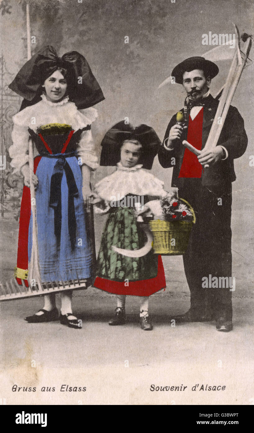 Folk in the traditional costume of Alsace Lorraine     Date: circa 1910s - Stock Image