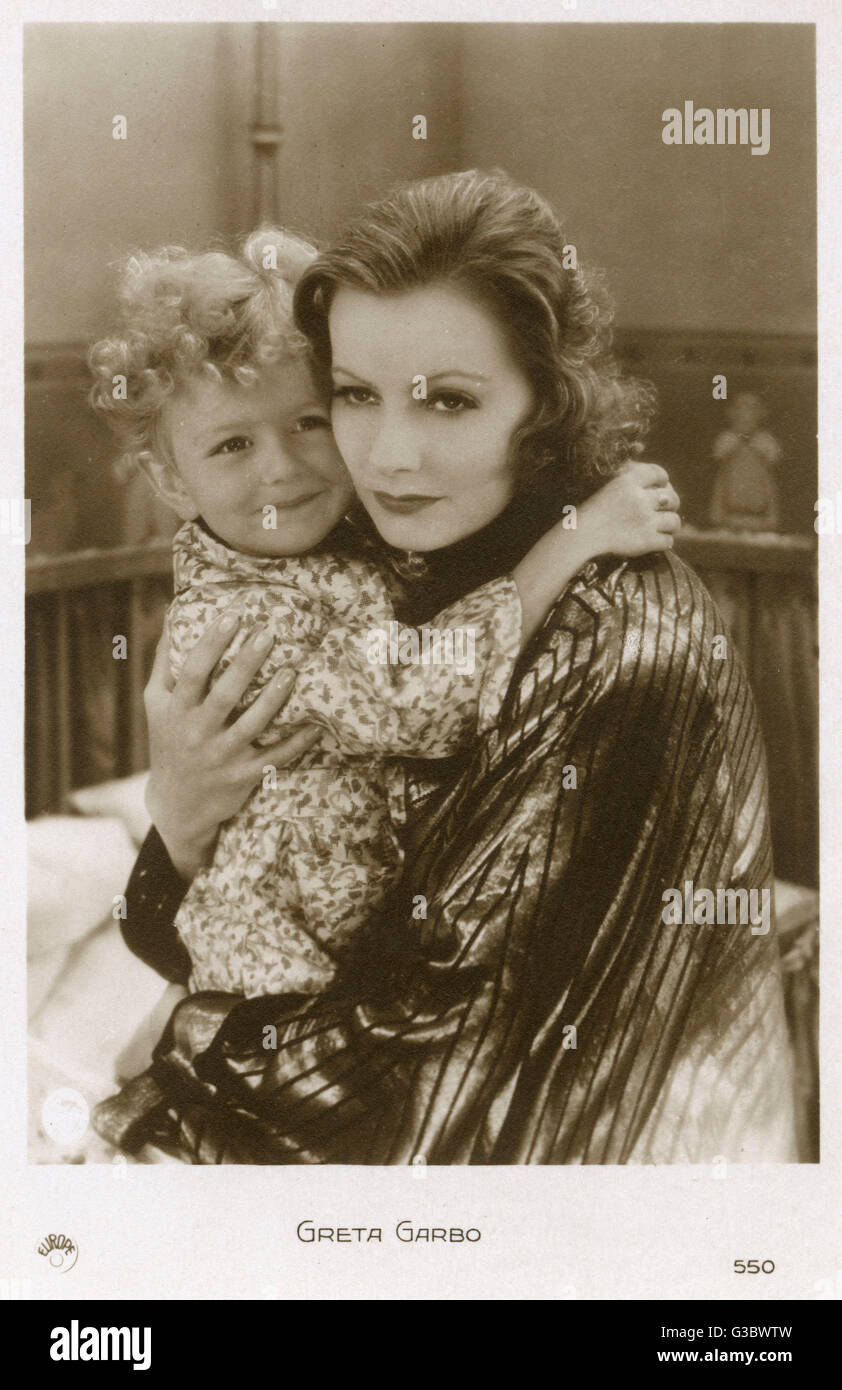 Greta Garbo (1905-1990) with a young boy     Date: circa 1930s - Stock Image