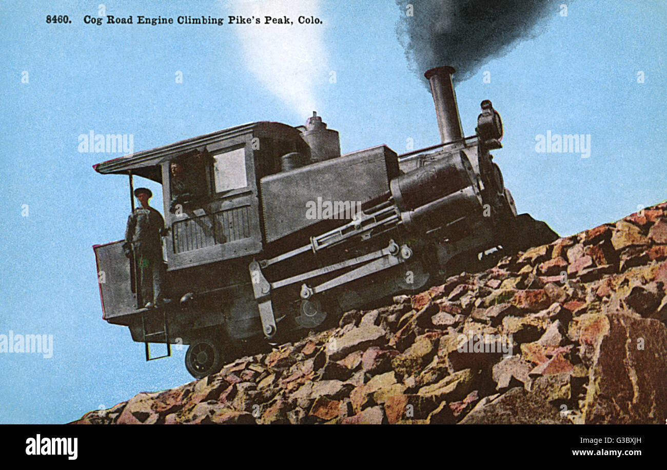 Cog road engine with crew climbing Pikes Peak, a mountain in the Rocky Mountains, Colorado, USA.      Date: circa - Stock Image