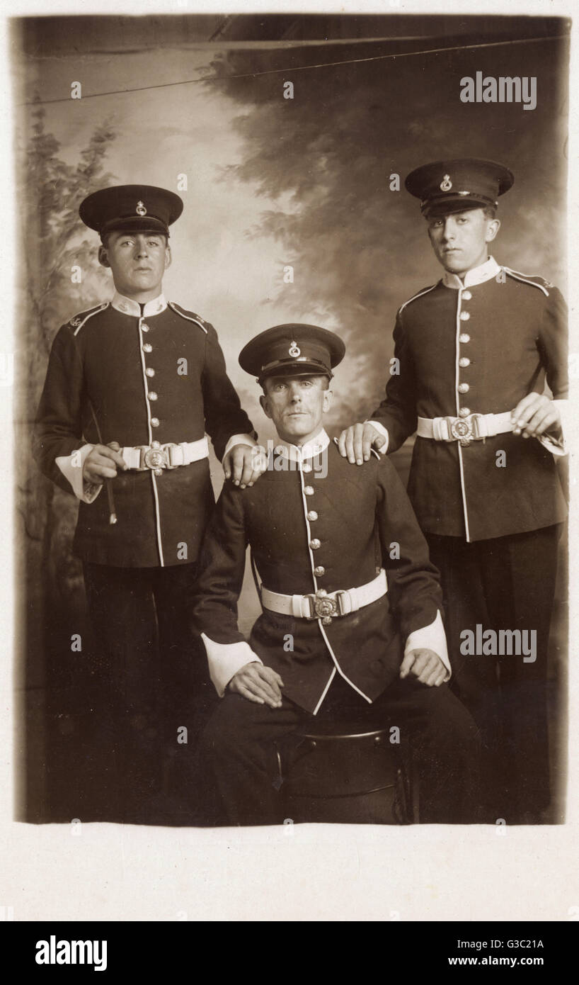 Two Hertfordshire Territorials pose for a photograph with their officer - Herts Regiment - Pre-WW1.     Date: circa - Stock Image
