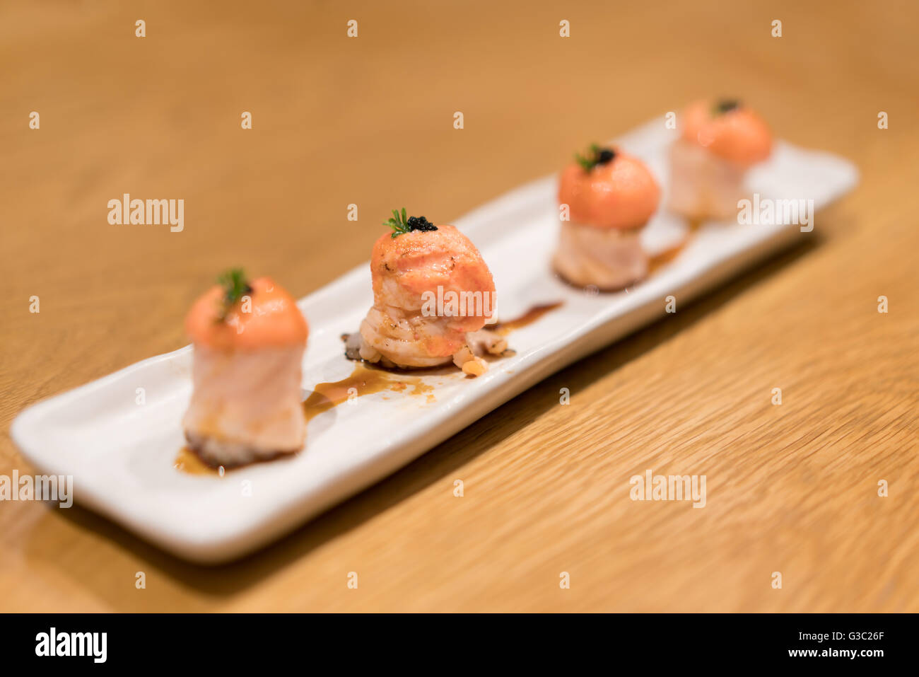 Salmon sushi in modern fusion style, depth of field effect - Stock Image