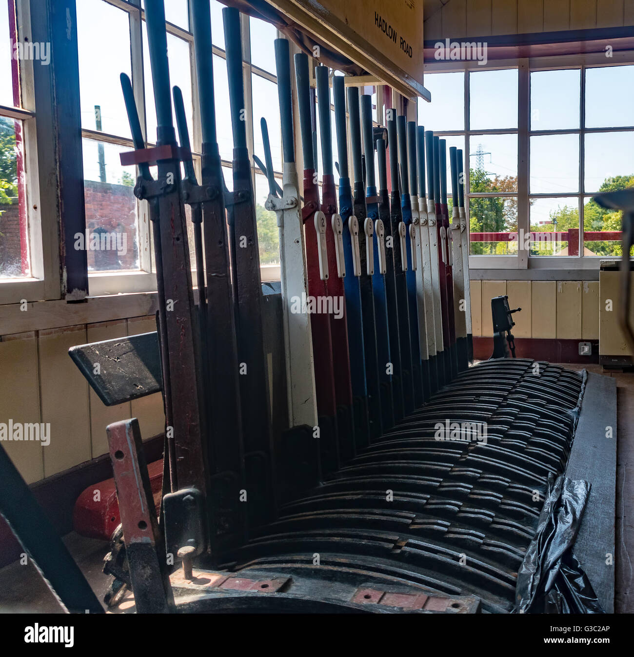 Old style railway signal box control levers - Stock Image