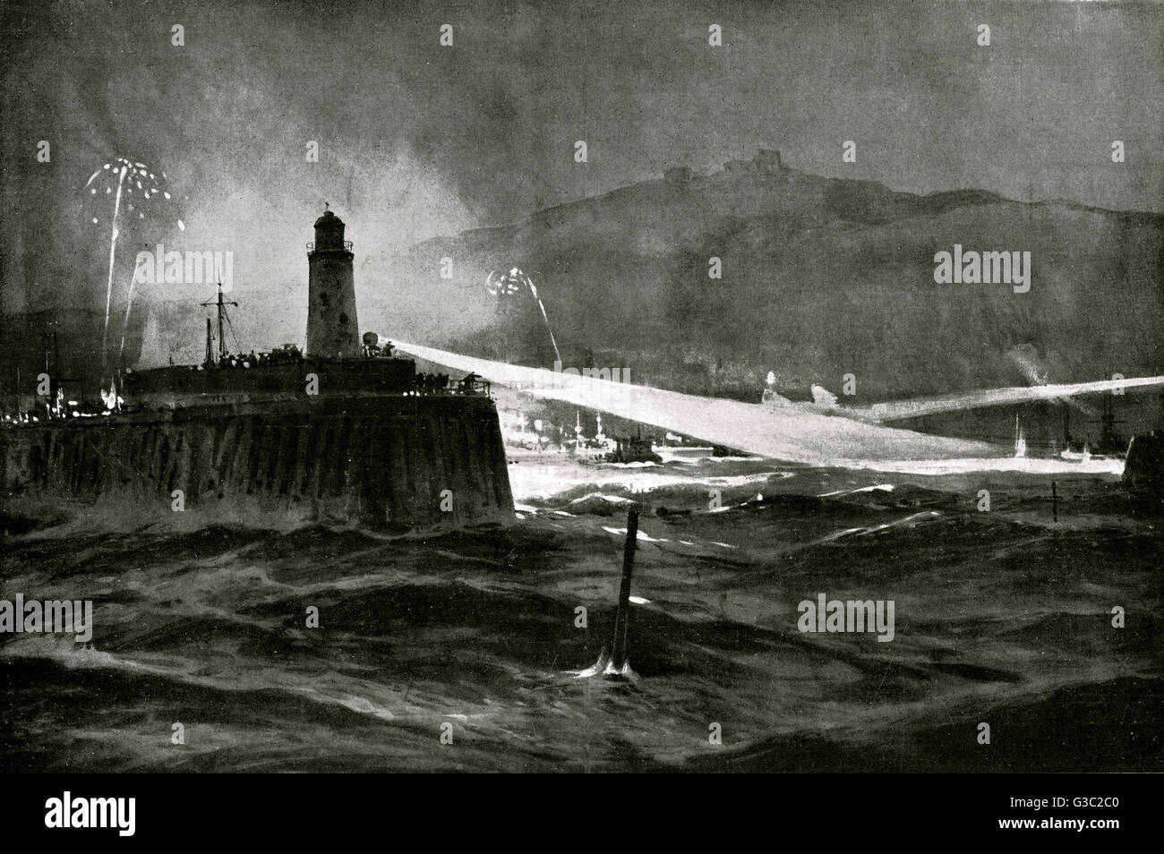 WW1 -  A scene of Dover at night as it's searchlights discover two German submarines at the entrance of the - Stock Image
