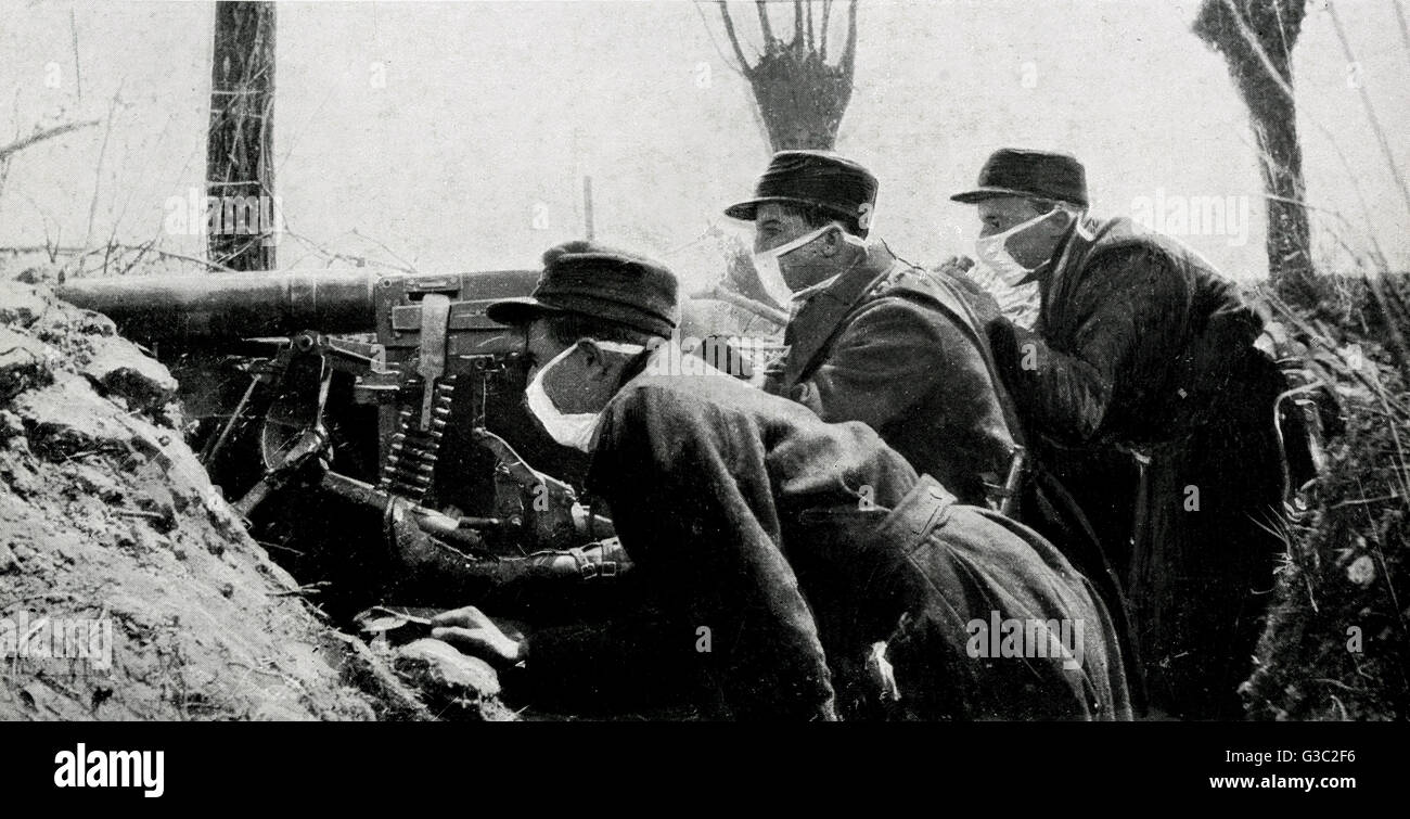 WW1 - A photograph showing three Belgian soldiers positioned in their trench, and their machine-gun ready to fire. Stock Photo