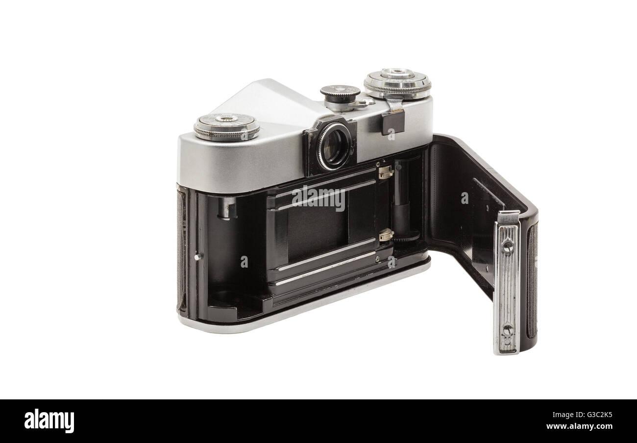 Retro soviet film camera isolated on white background. Soviet reflex camera. Opened back side - Stock Image