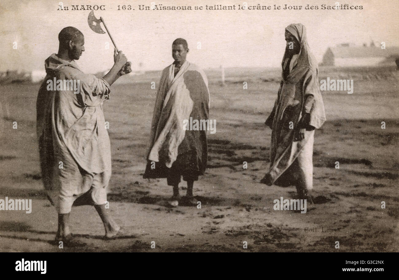 A member of the snake charmers cult The Aissaoua Brotherhood ceremonially cuts his head on the 'Day of Sacrifices' - Stock Image