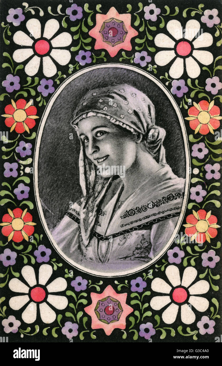 Serbian Country Girl - Decorative floral border.     Date: circa 1910s - Stock Image