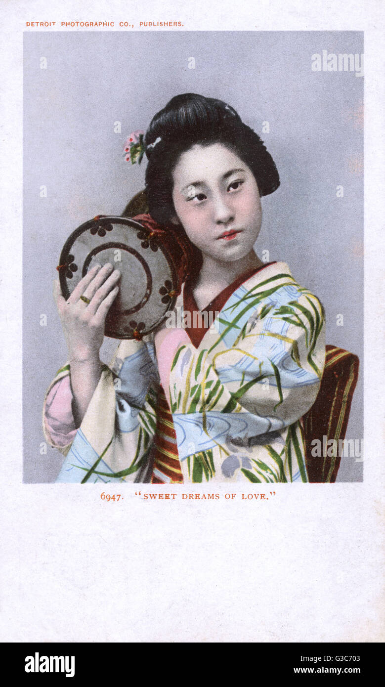 Japanese girl playing a small drum - titled 'Sweet Dreams of Love'.     Date: circa 1910 - Stock Image