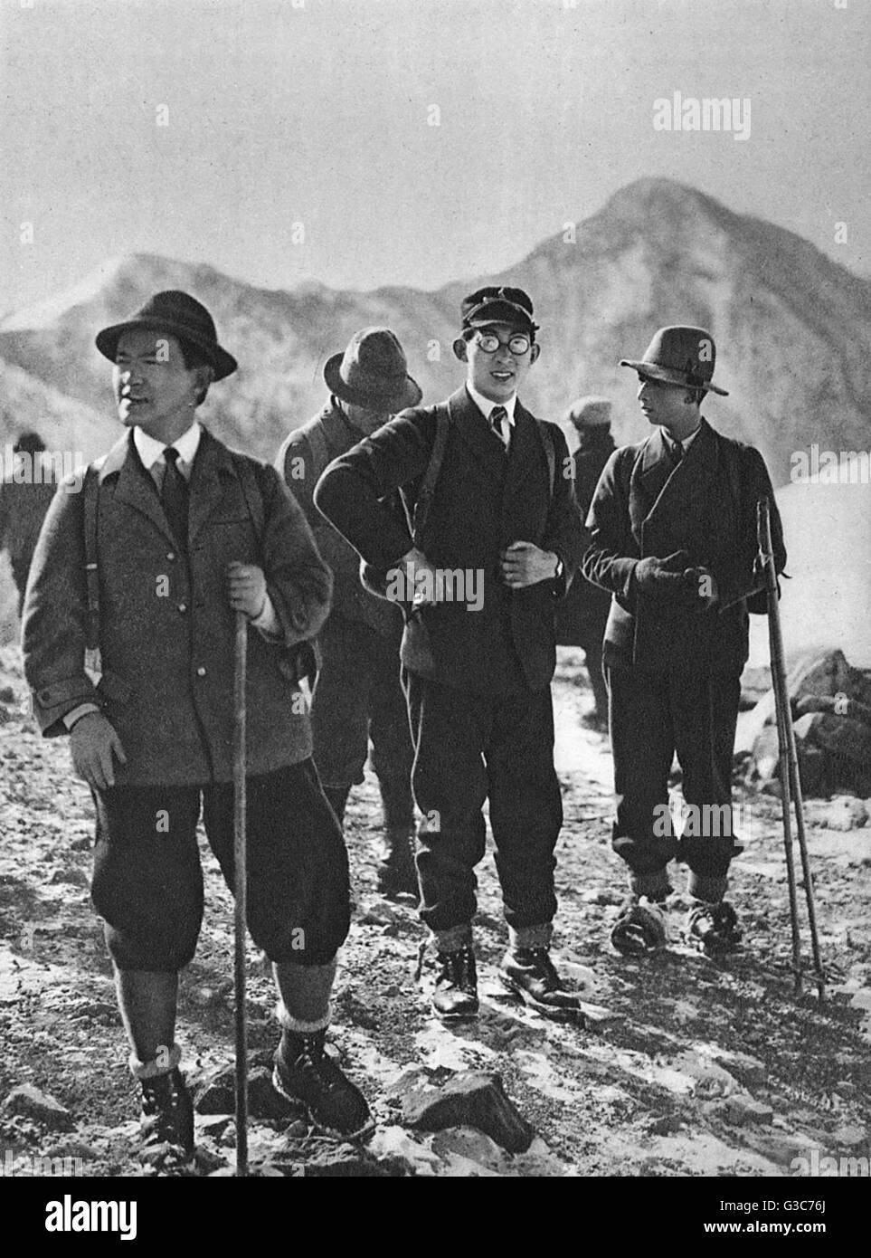 A group of Japanese mountaineers are accompanied by 'H.I.H Prince Chichibu' in the centre of the frame. - Stock Image