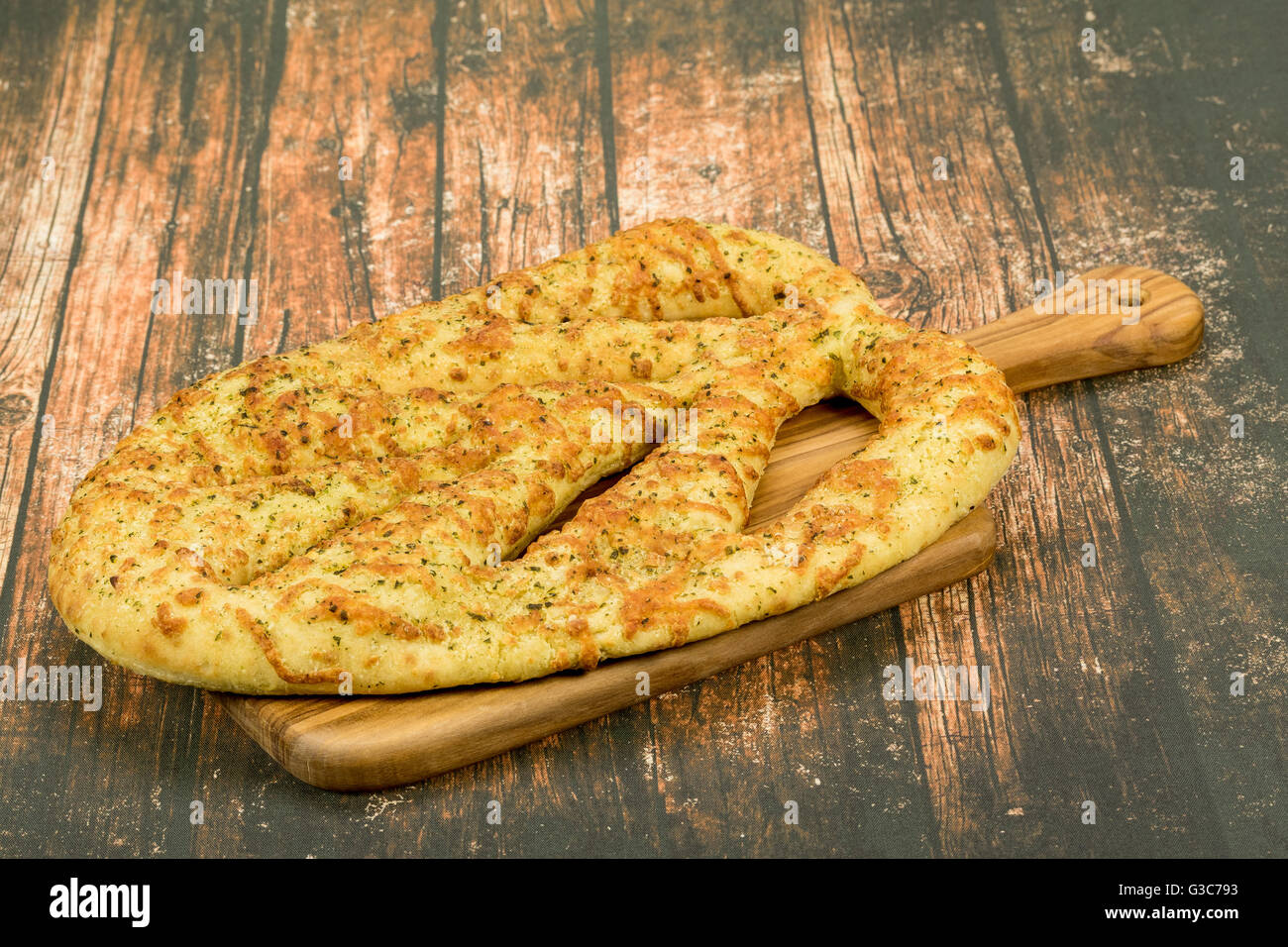 An authentic French Fougasse or Foccaccia bread from Provence, France.   This bread is made with olive oil, garlic, - Stock Image
