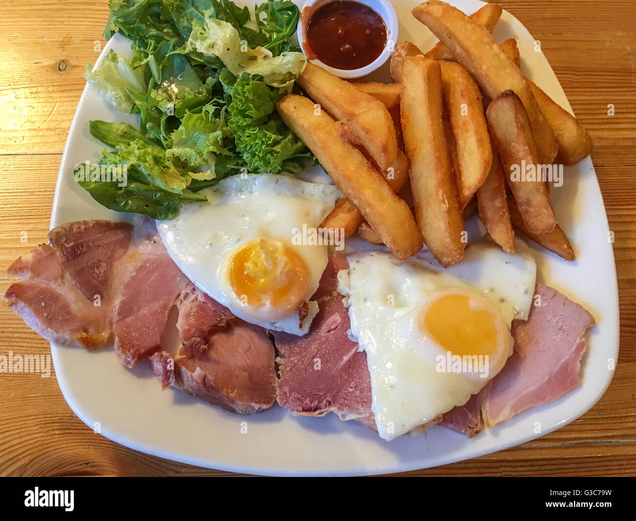 Ham, egg and chips pub bar meal - Stock Image