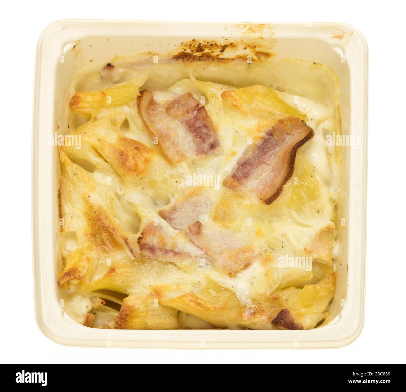 A baked chicken and bacon pasta ready meal - white background - Stock Image