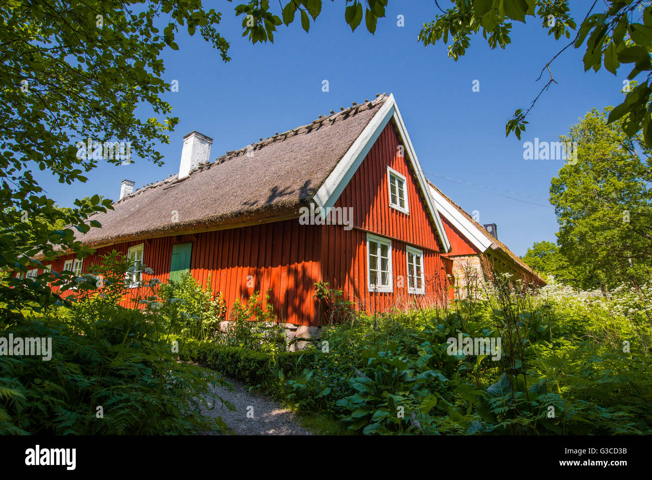 A traditional red Swedish house stands in Skansen, Stockholm. - Stock Image