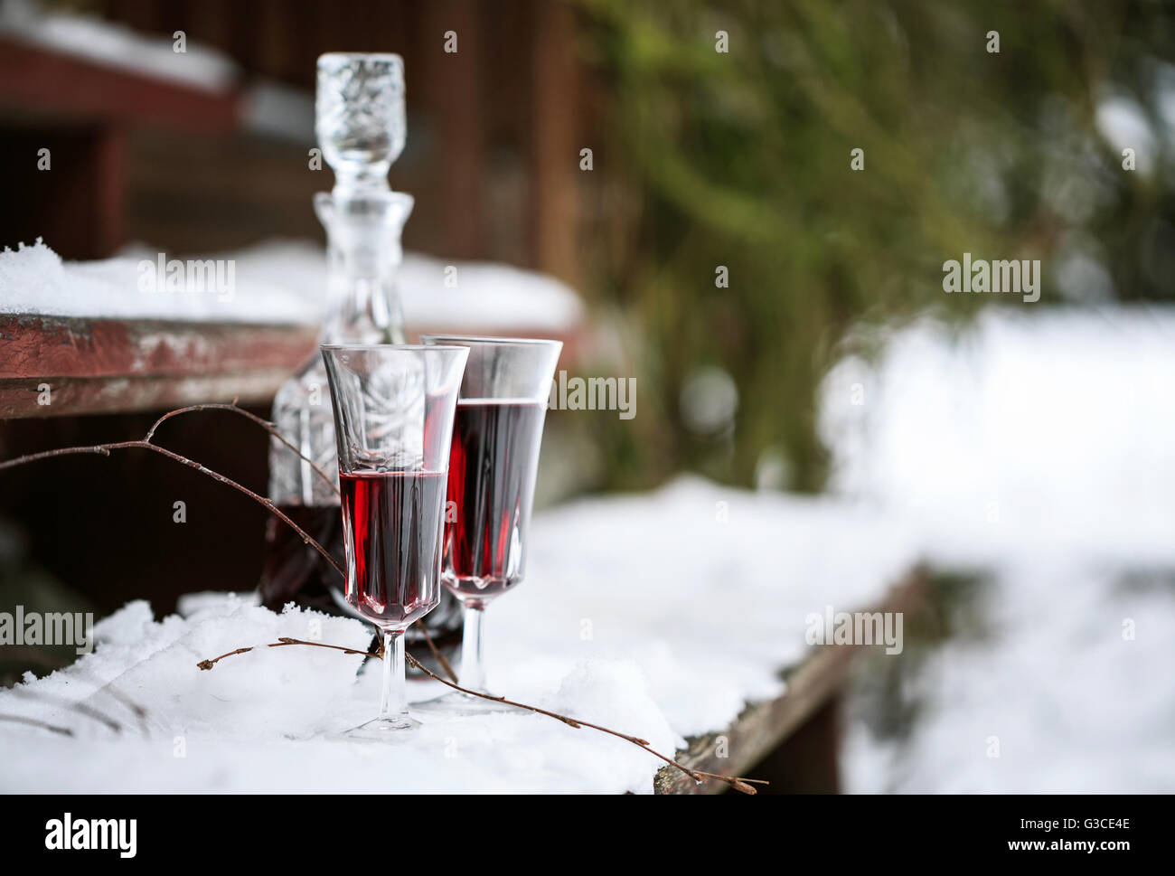 Decanter and wineglasses of red wine outdoors Stock Photo