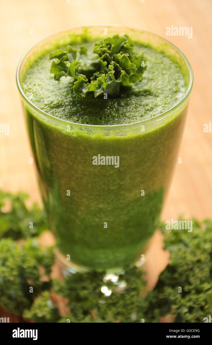 Healthy green smoothie with kale in a glass - Stock Image