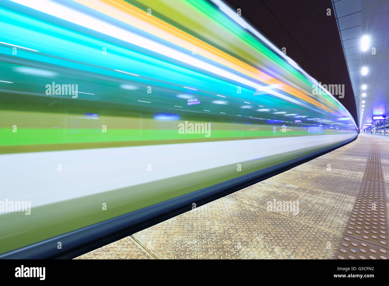 Train in motion at the station - Stock Image