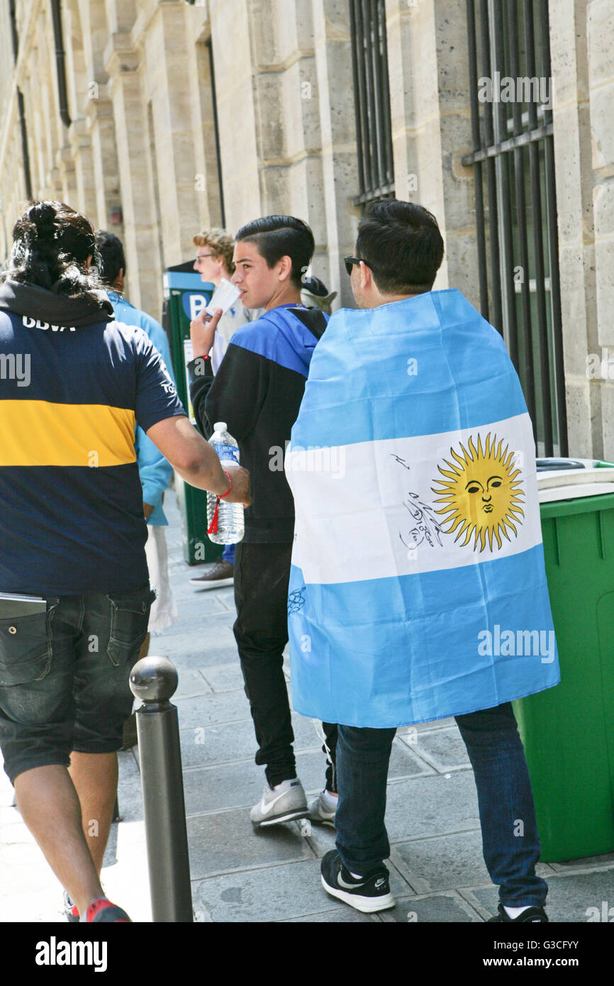 Funs of soccer, man with Argentinian flag with the autograph of Diego Maradona, Paris, France - Stock Image
