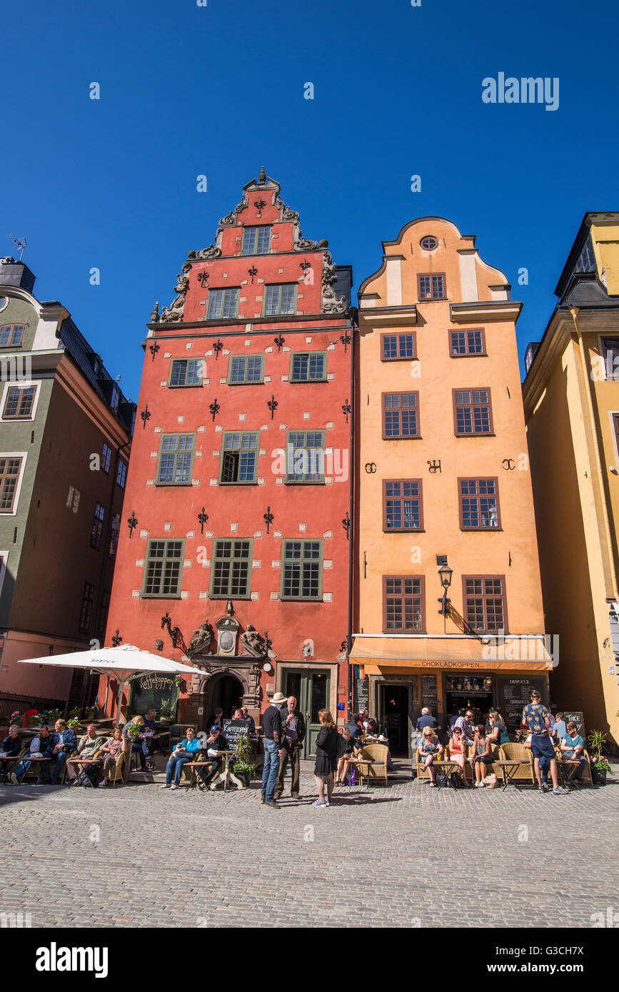 Tourists wonder the streets of Stockholm's historic Stortorget square in the summer. - Stock Image