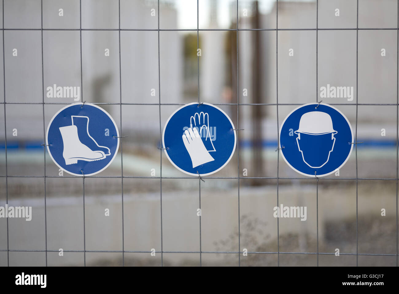 Different mandatory-signs on a construction site - Stock Image