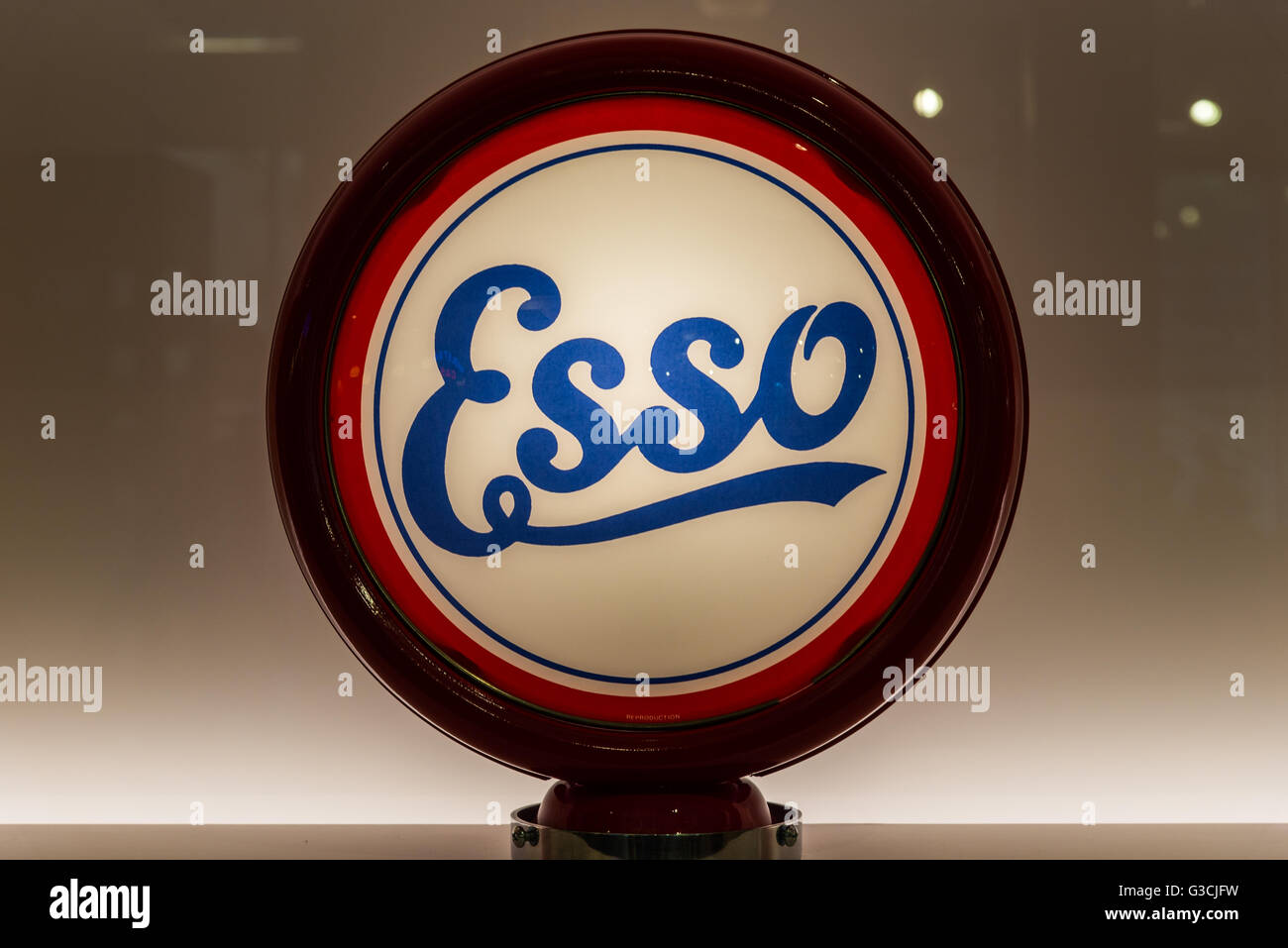 Glass globe for vintage Esso gas pump in display. - Stock Image