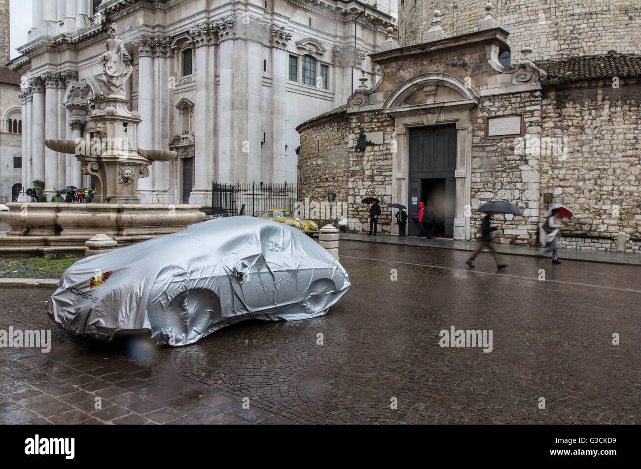 Car in storm, cover, rain, Mille Miglia - Stock Image