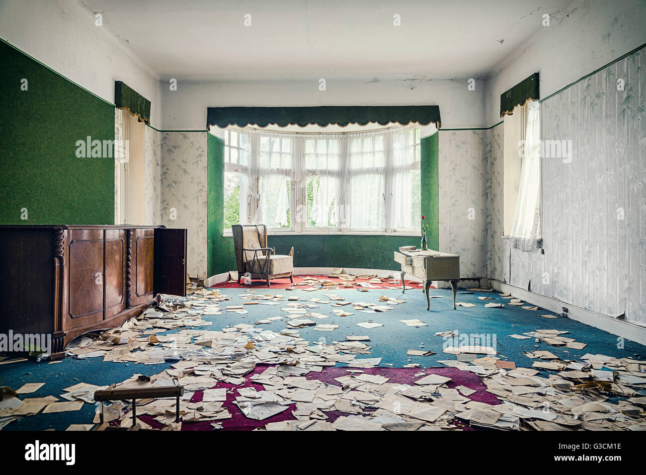 Reading room in an abandoned villa with book pages - Stock Image