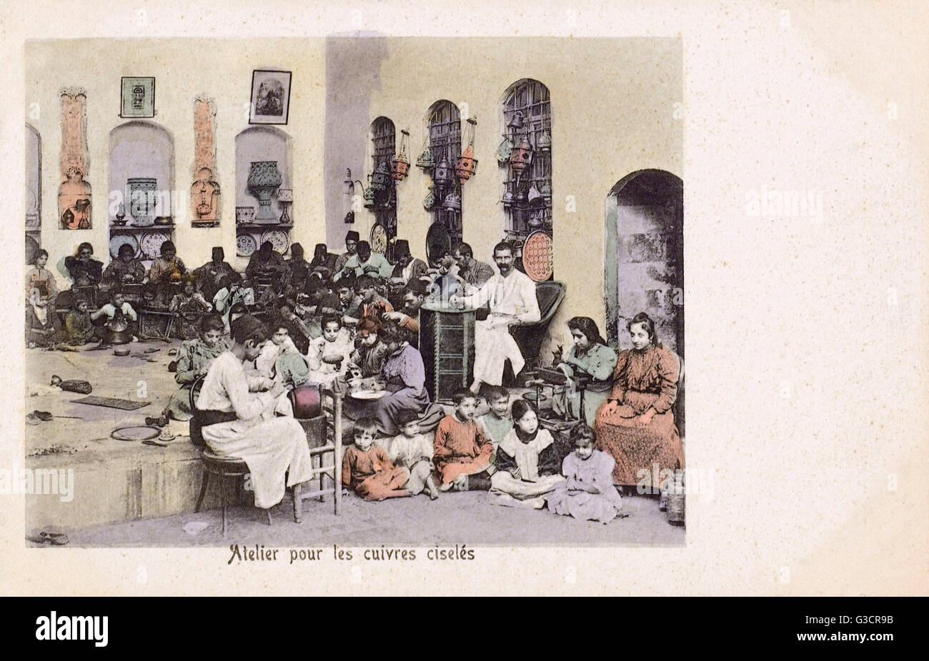 Syria - Jewish Workers producing Engraved Brasswork     Date: circa 1905 - Stock Image