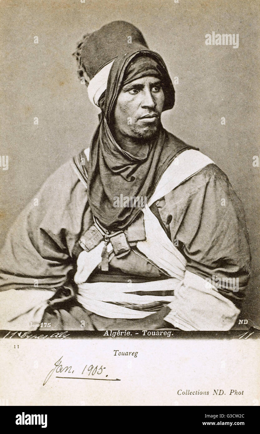 An absolutely superb portrait photograph (reproduced on a postcard) of a Tuareg tribe of the far southeastern Algeria, - Stock Image