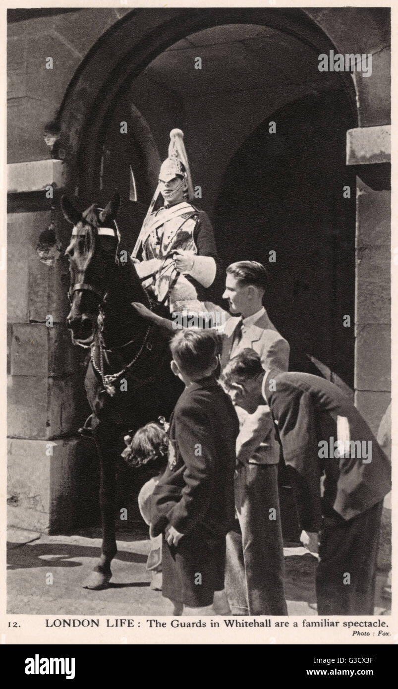 London Life: The Guards at Whitehall - a familiar spectacle.     Date: circa 1940 - Stock Image