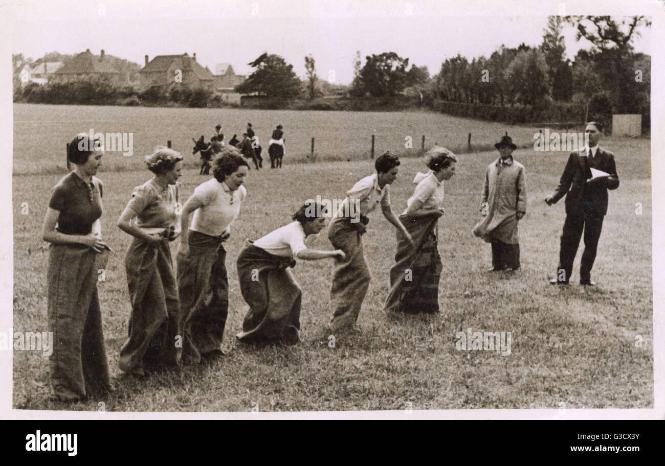 WW2 - Home front - Land Army Girls having a sack race during some time off.     Date: August 1942 - Stock Image